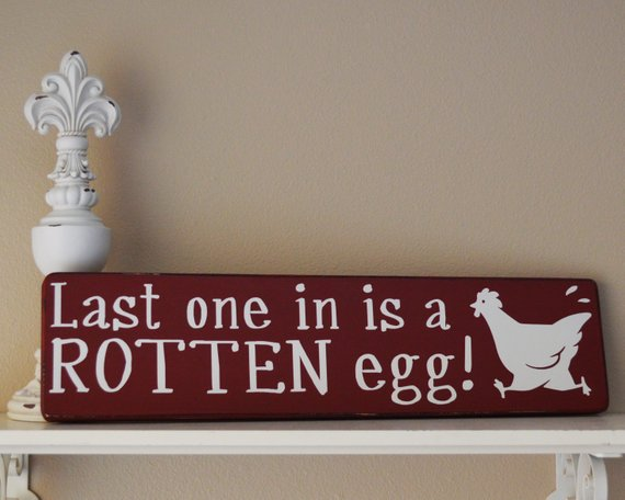 chicken coop sign: last one in is a rotten egg