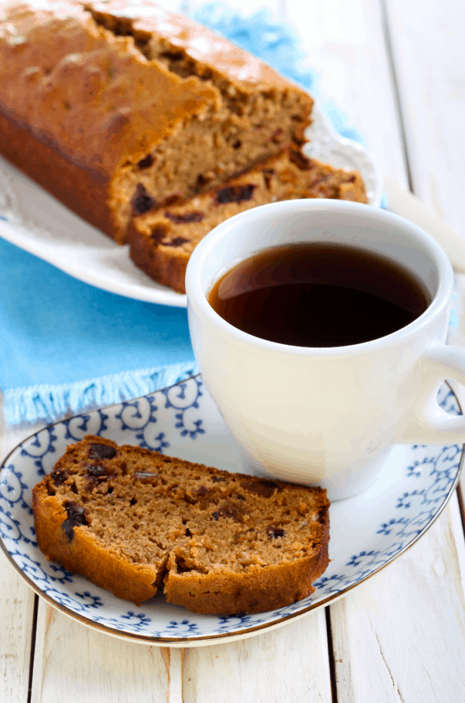 Coffee cake and a coffee cup