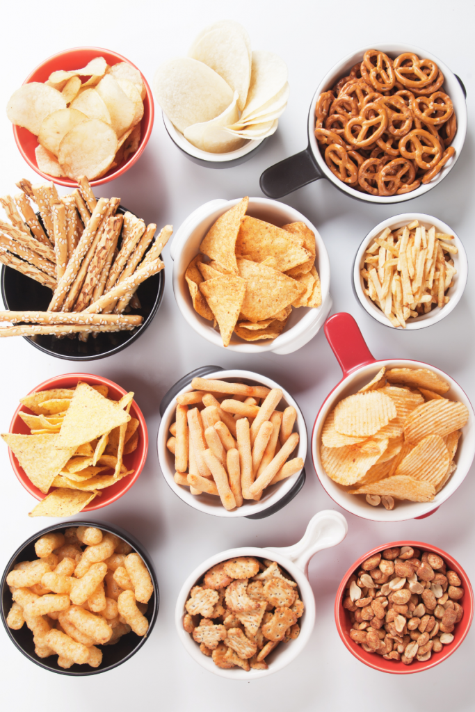 Bowls full of salty snack foods.